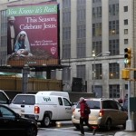 A billboard sponsored by a Catholic group is displayed near an exit of the Lincoln Tunnel in New York, Wednesday, Dec. 1, 2010. Similarly, a billboard sponsored by an atheist group is displayed near the tunnel's New Jersey entrance. (AP Photo/Seth Wenig)